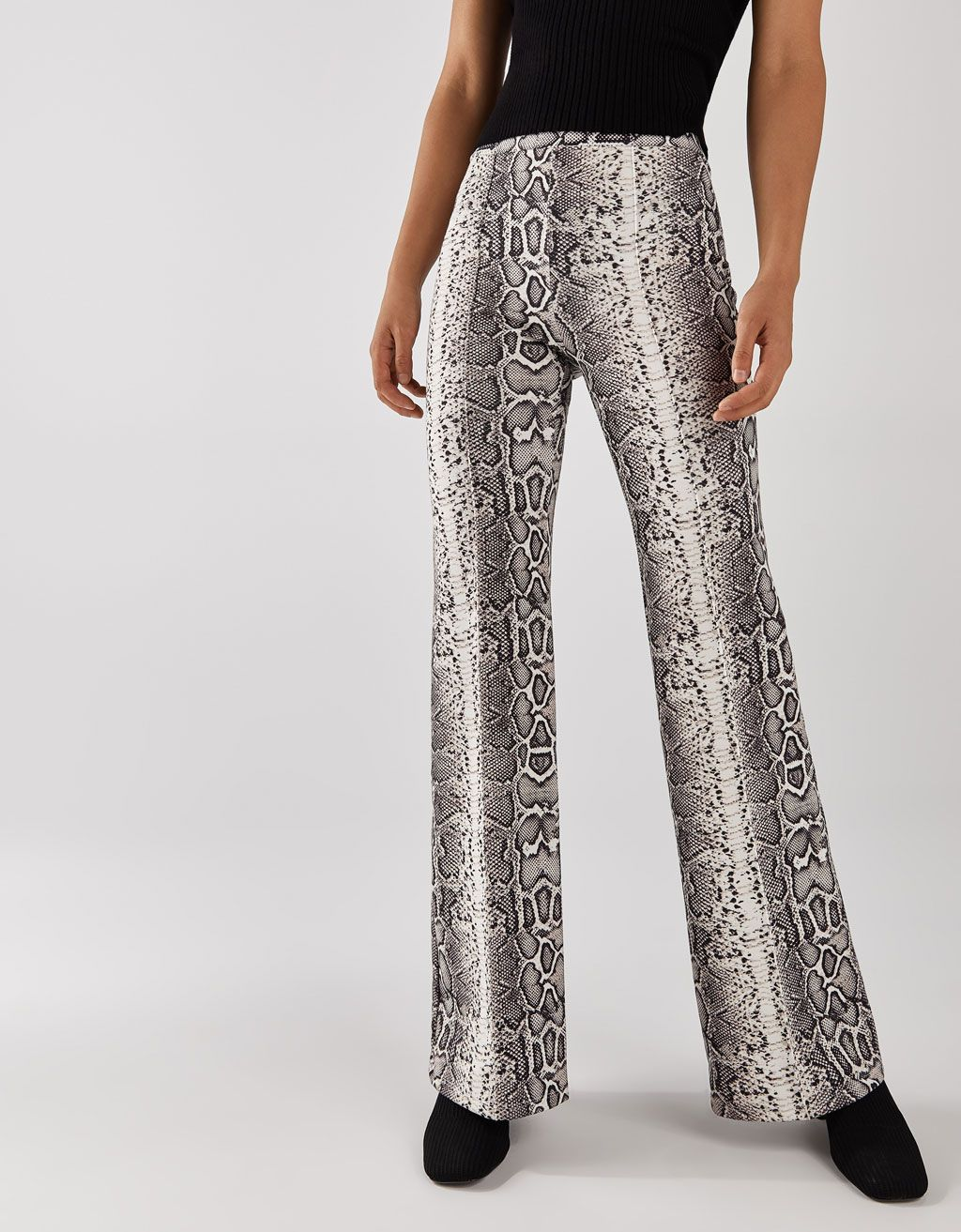 1233a5e6f3 Flared trousers with serpent print