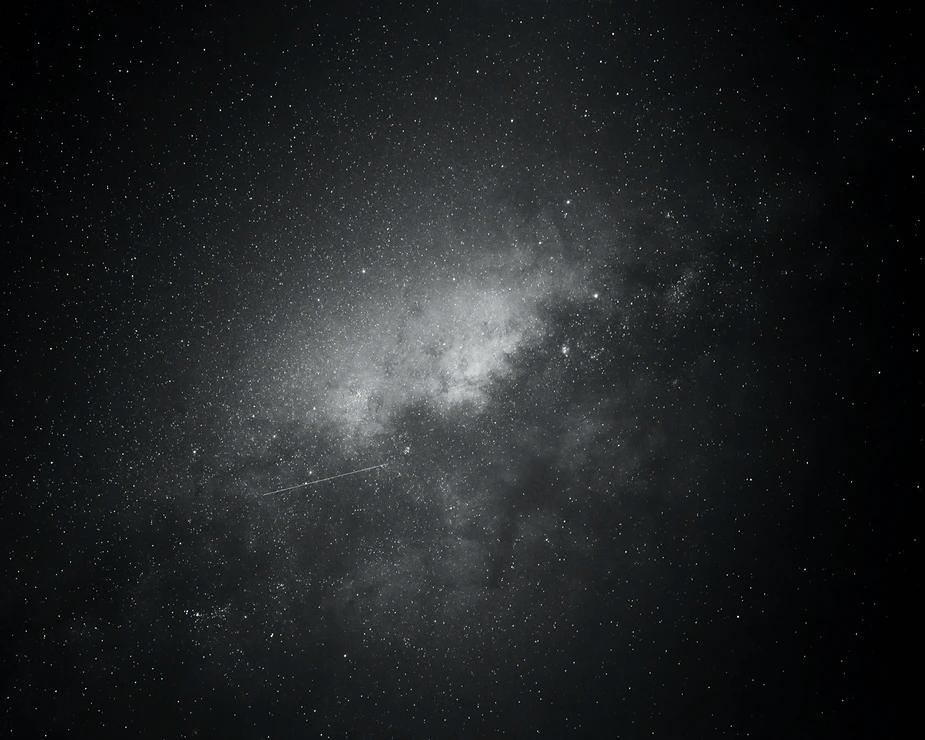 Gray Galaxy Photo Free Black And White Image On Unsplash Black And White Background Galaxy Black And White Galaxy Photos