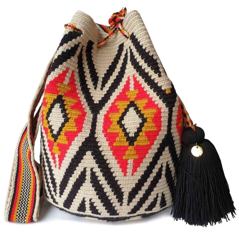 Wayuu Bags   FairTrade + Womanmade - Wayuu bag, Wayuu bags pattern, Tapestry bag, Bag pattern, Crochet bag, Bags - The stunning, oneofakind, 100% handmade crossbody has been carefully crocheted by women from the Wayuu tribe in La Guajira, Colombia  This versatile Wayuu bag is perfect for a night out, running errands, hiking, relax on the weekend, or to take to the gym  This beautiful Wayuu bag that you are seeing was carefully crafted using a double thread technique for the body  The strap is tightly handwoven using the same technique used for single thread bags  As a result, the strap will not stretch  The drawstring as well  This piece represents approximately 1015 days of work for a single artisan   	See here for care instructions  	Check out the different ways to wear a Wayuu bag SPECIFICATIONS Material Acrylic blend Length 28 cm Height 32 cm Strap 100 cm (As the product is handmade, each bag can vary by 1 inch or so ) EXCHANGES ACCEPTED Exceptions may apply  See our Return Policy  WHAT OUR CUSTOMERS SAY Jan 12, 2020 by Arisa, USA on LOMBIA Wayuu Bags   FairTrade + WomanmadeThank you so much and got the beautiful bag! I love it  Cute color and good size  Cant wait to use it Jan 6, 2020 by Francesca on LOMBIA Wayuu Bags   FairTrade + WomanmadeI wanted to let you know that the bags arrived today and they are truly some of the best I have seen Jan 3, 2020 by Anonymous on LOMBIA Wayuu Bags   FairTrade + WomanmadeRomy recibio las mochilas todo perfectamente! Muchisimas gracias por tu buen servicio! Una vez mas mil gracias por todo!Page 1 of 39 « ‹ 123› »