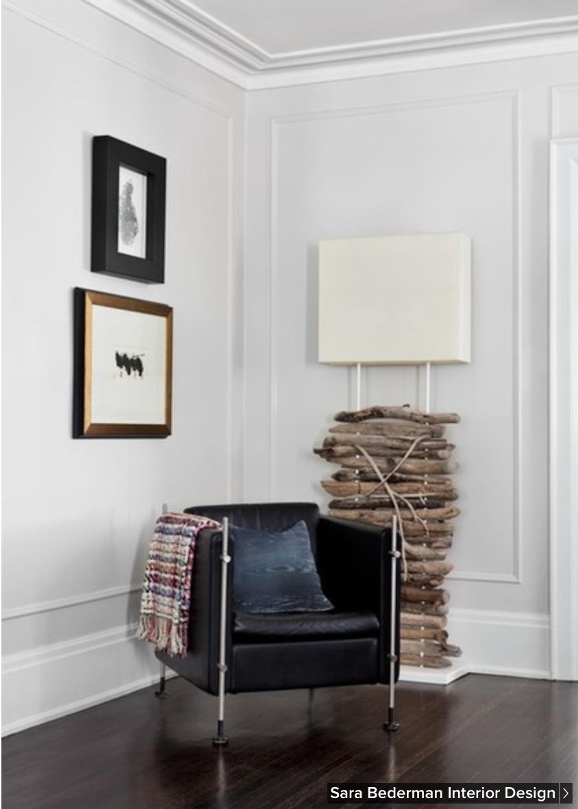 Dark wood floors, light walls and drift wood lamp   Crown moldings ...