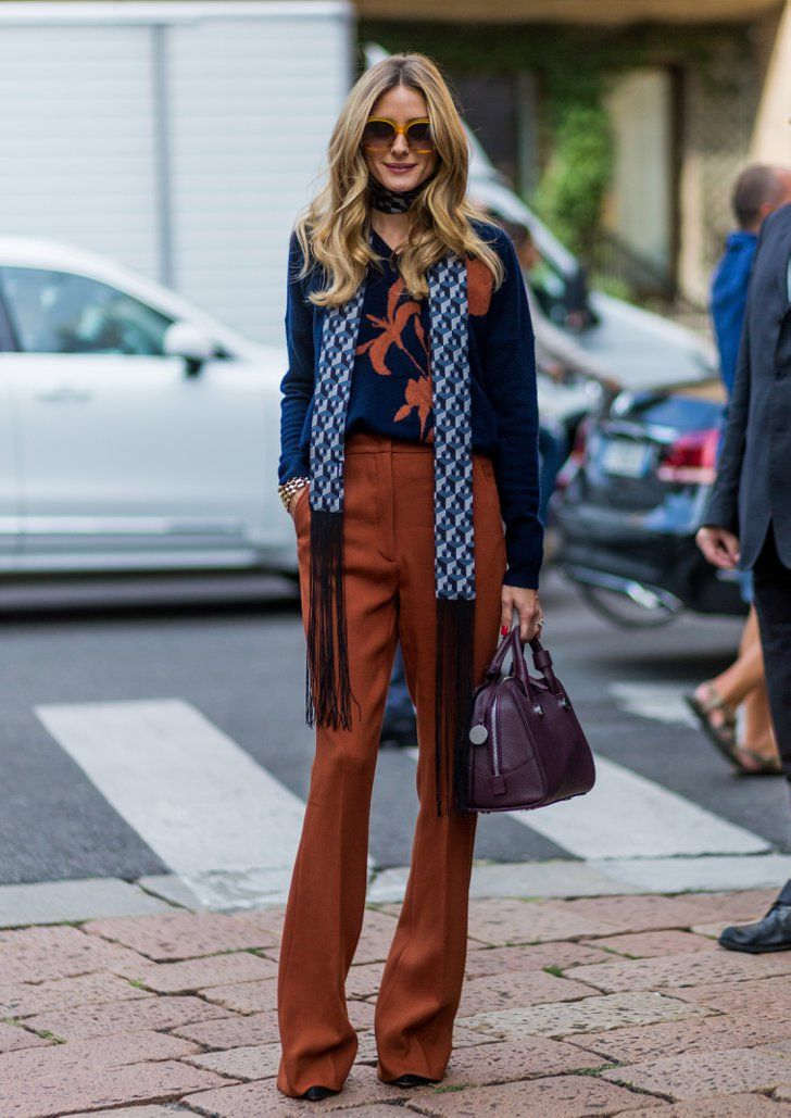 The shade of Olivia's Tibi pants complimented the pattern on her navy sweater.