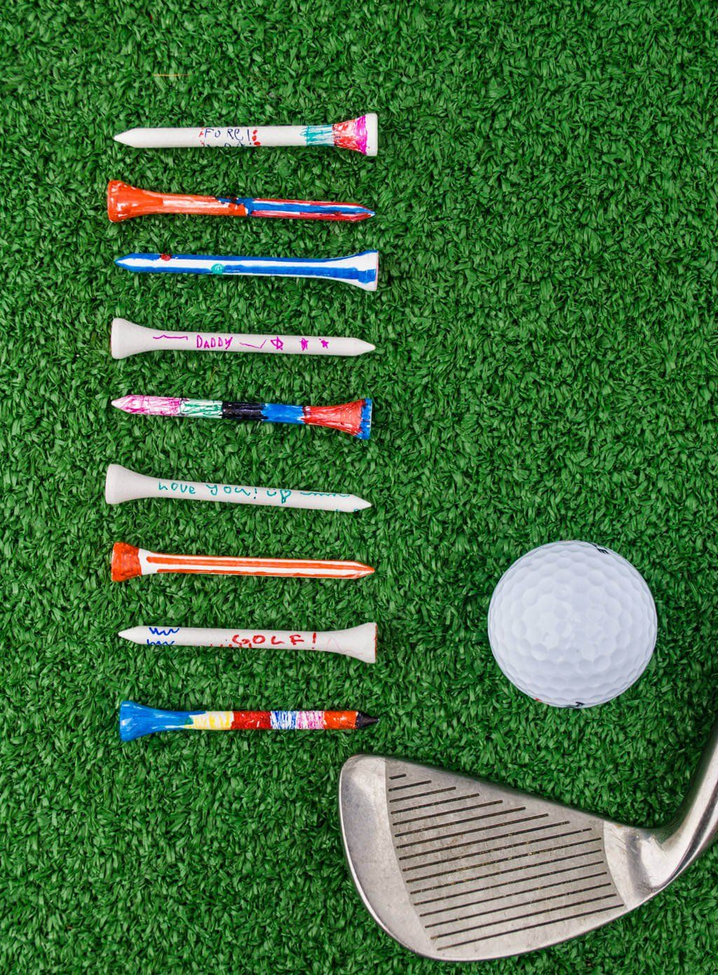 DIY Father's Day Gifts from Kids Sharpie Golf Tees is part of DIY Kids Crafts For Dad - Make this DIY Father's Day gifts from kids colorful DIY painted golf tees with cute stripes, doodles and smiles  It's a quick and easy kid's craft