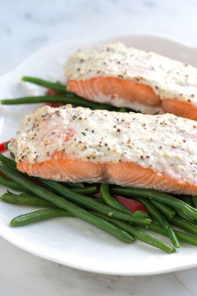 Easy four-ingredient baked salmon recipe topped with a mixture of sour cream, mustard, and parmesan cheese. Plus, how not to overcook salmon.