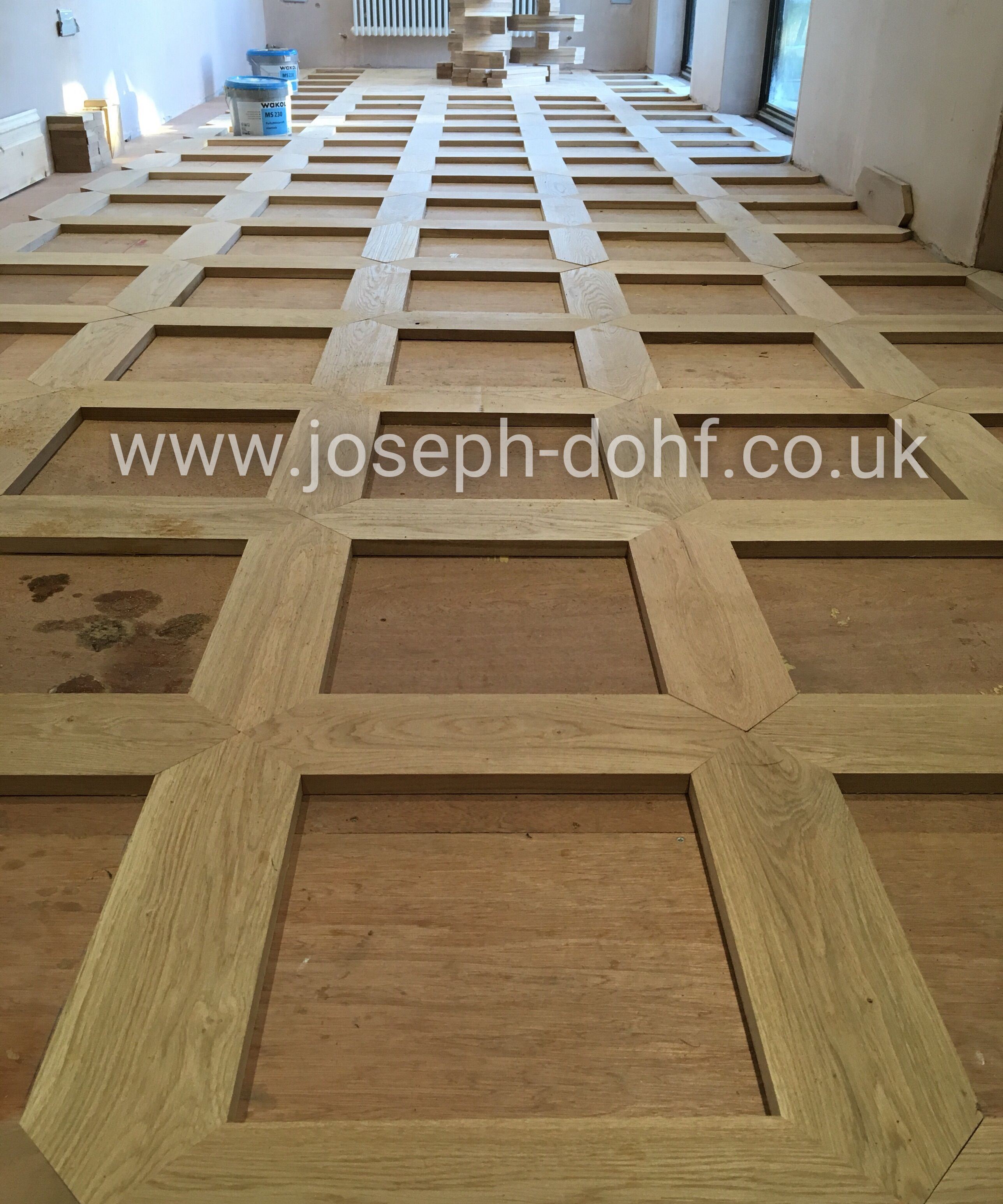 Bespoke Oak Pattern Floor Laying Out The Frame Of The Design