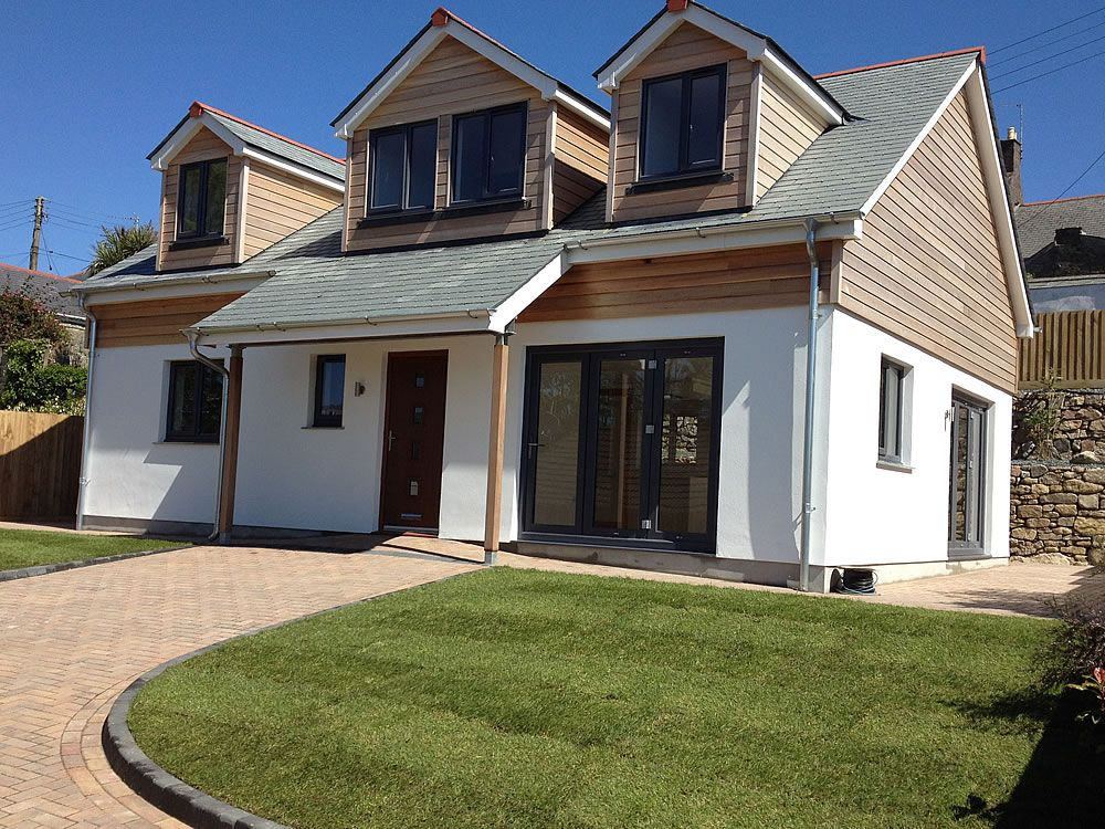 This development was of a 4 bed roomed dormer bungalow for Bungalow exterior design