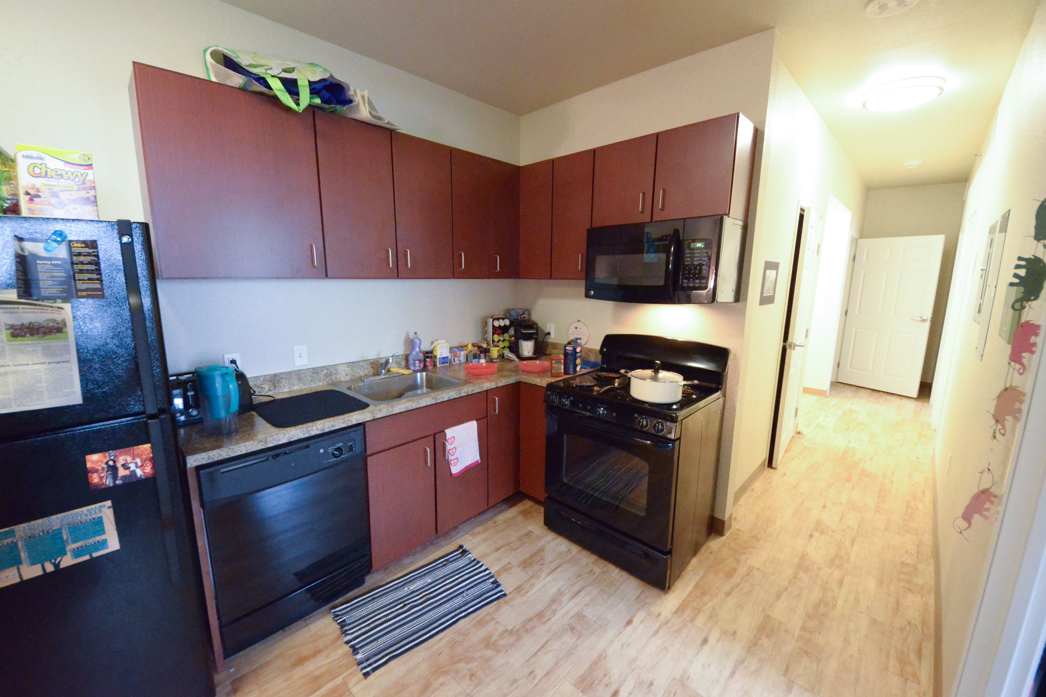 The Kitchen Area Of A Dorm In Euclid Commons.