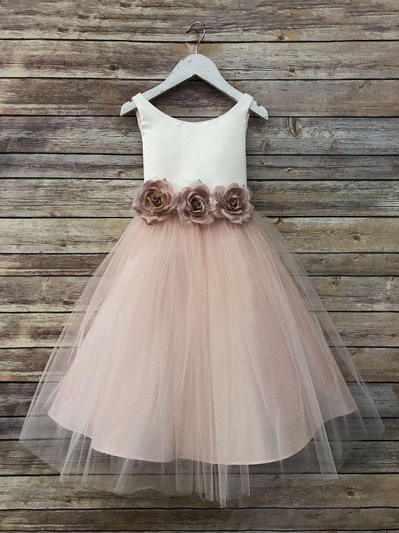 8057c29b2ea Two tone dress features ivory top with rose pink color tulle skirt. Satin  belt ties in the back. Three removable silk flowers. Tea length style dress.