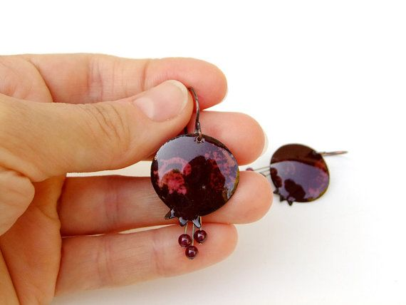 These fashion pomegranate-shaped enamel #earrings are made in dark #maroon color with #garnet beads.   They are one of a kind and totally handmade.  I cut pieces of sheet copp... #handmade #jewelry #harvest #pomegranate #merlot