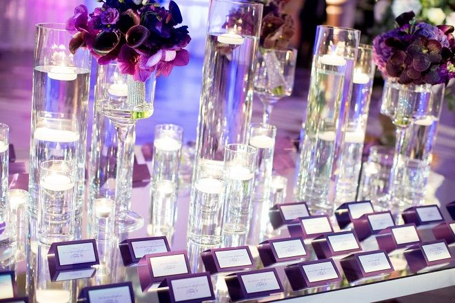 Black Tie Card Table With Purple Flower And Glass Covered Candles Mirrored
