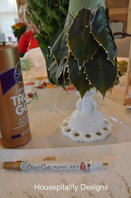 Crafty Chicks Craft Party made decorative Christmas trees. This one has a vintage milk glass candlestick as a base, and some nice gold edging on the leaves.