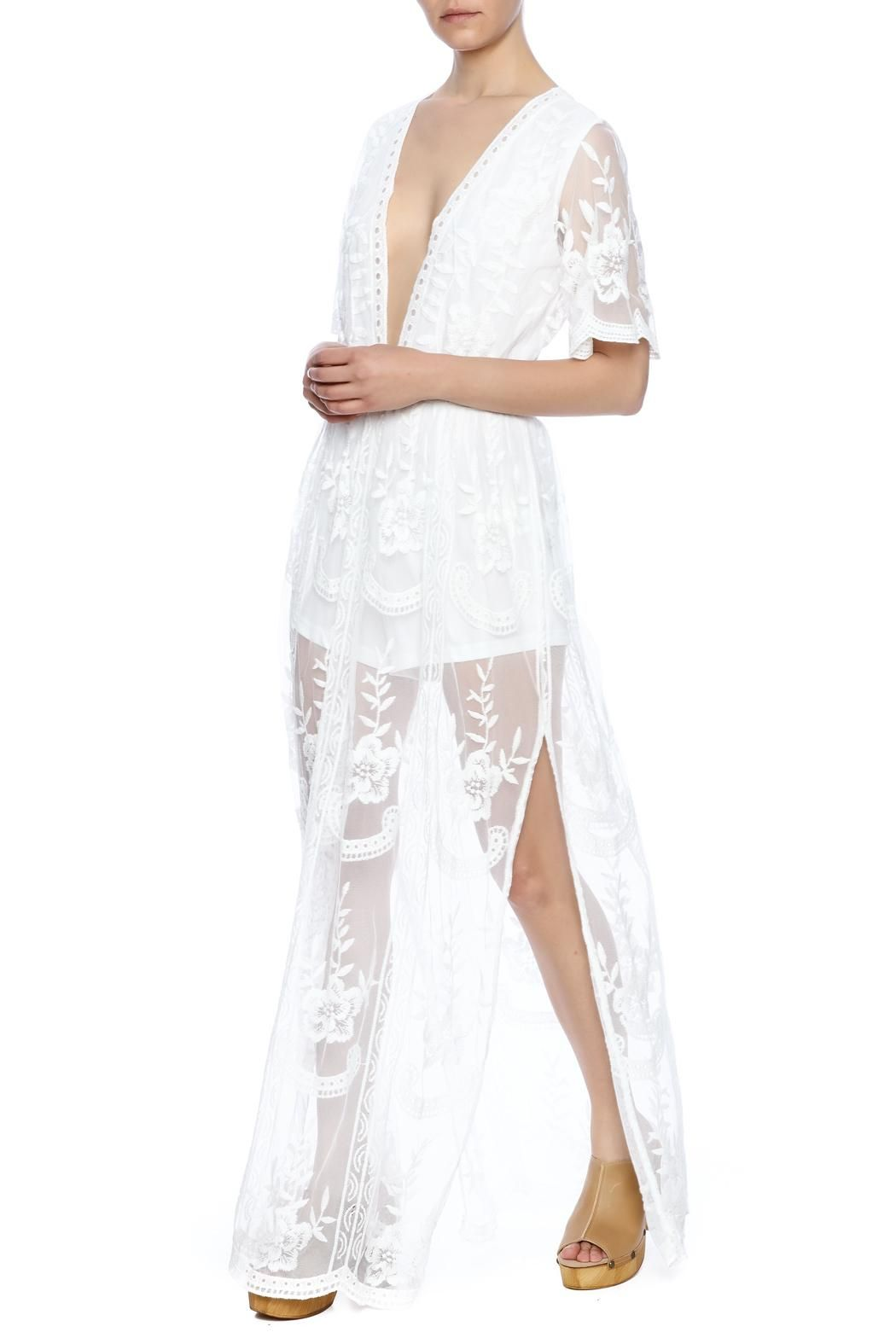 d1b337cf749 Romper with lace   crochet maxi overlay. Plunging neckline and zip back  closure. Double