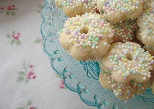 Mini Sprinkle Sugar Cookies ~ buy some flower butter cookies, dip top in pink glaze (powdered sugar with 2 drops red color),  top with pastel sprinkles ~ & viola ~ shabby chic cookies with NO BAKING!! :o)
