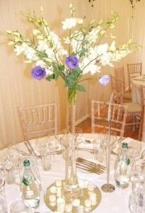 Tall vases wedding flower centerpieces - The Wedding Specialists