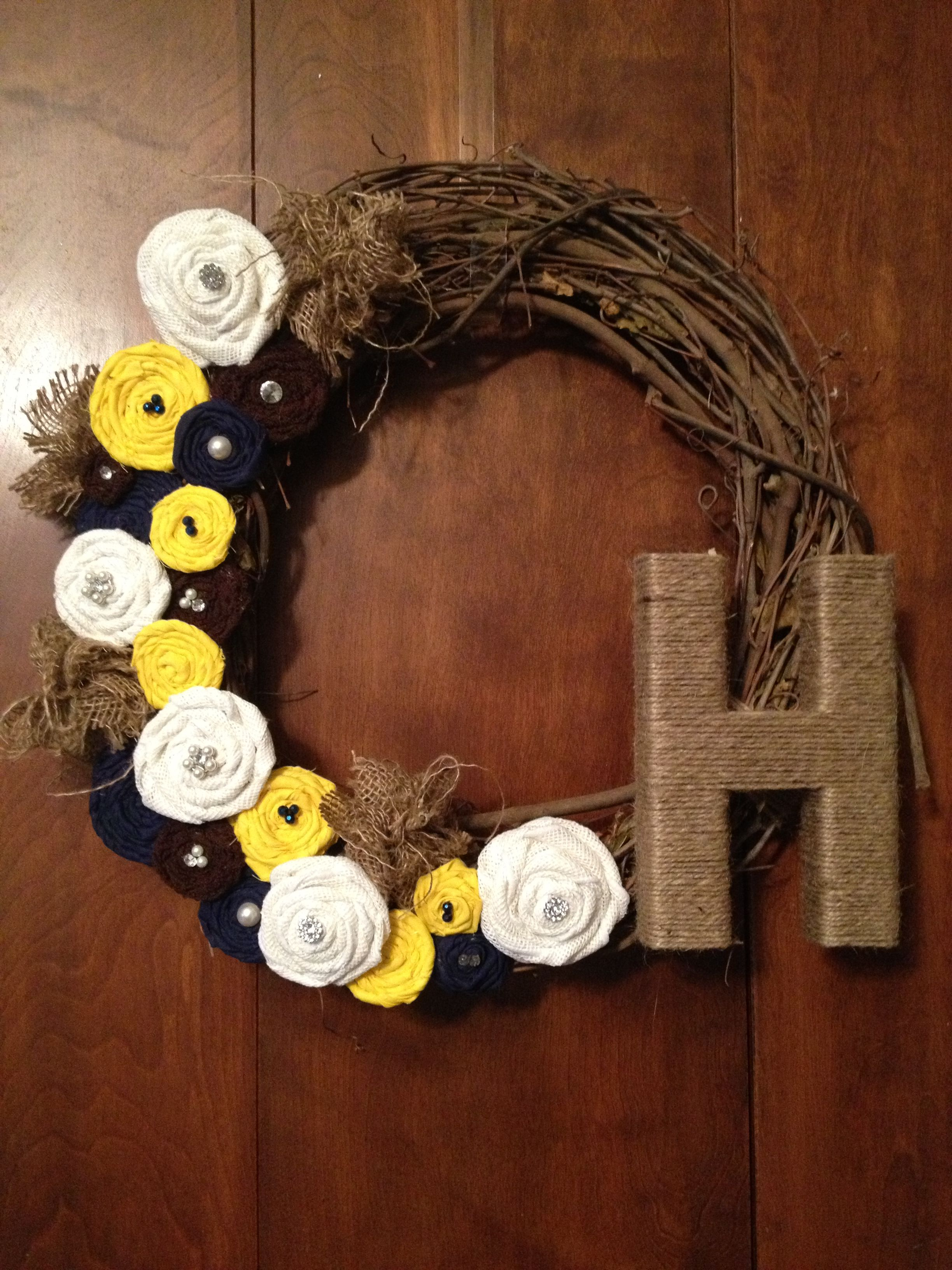 DIY Initial Grapevine wreath.. Burlap, navy and yellow!!  Made a GREAT bridal shower gift!! :)