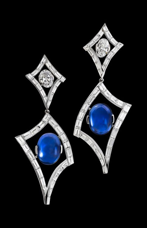 """Alexandre Reza """"Air"""" Earrings featuring 2 unheated Burmese oval cabochon sapphires weighing 12.06cts and 11.27cts. Top part includes 2 oval diamonds weighing 2.21cts (one D. IF and the other one D. WS1), surrounding baguette diamonds weighing 10.90cts."""