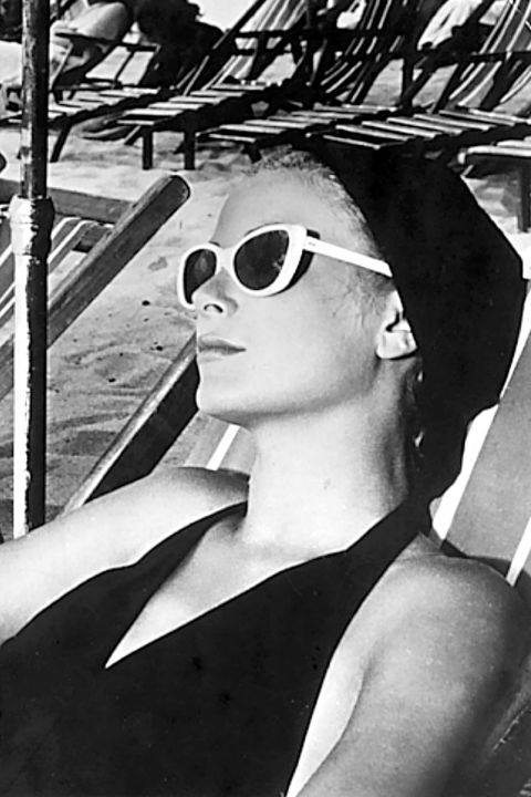 20 most iconic beach hair of all time: Grace Kelly opts for a covered approach by accessorizing with a hair wrap for a laid back, cool look.