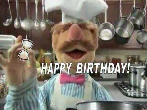 The Muppet Show's Swedish Chef dancing in the kitchen to wish you a