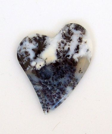 Medicine Bow Agate Heart Cabochon 2527 $18.95 Medicine Bow Dendritic Agate is a white agate with black manganese spots or dendrites. It is found in veins and bubbles in rock that has been permeated by volcanic gasses. Medicine Bow Agate comes from the west side of the Laramie Range in the Wyoming Medicine Bow Country. Dendrites are tree-like inclusions, and were named after the Greek word meaning tree-like.