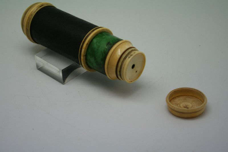 arly refractive telescope single draw ivory leather glass 13,3 cm long ivory rings 5,3 cm in diameter the ivory ring near the objective has a crack and the ring with the lens has room therefor.