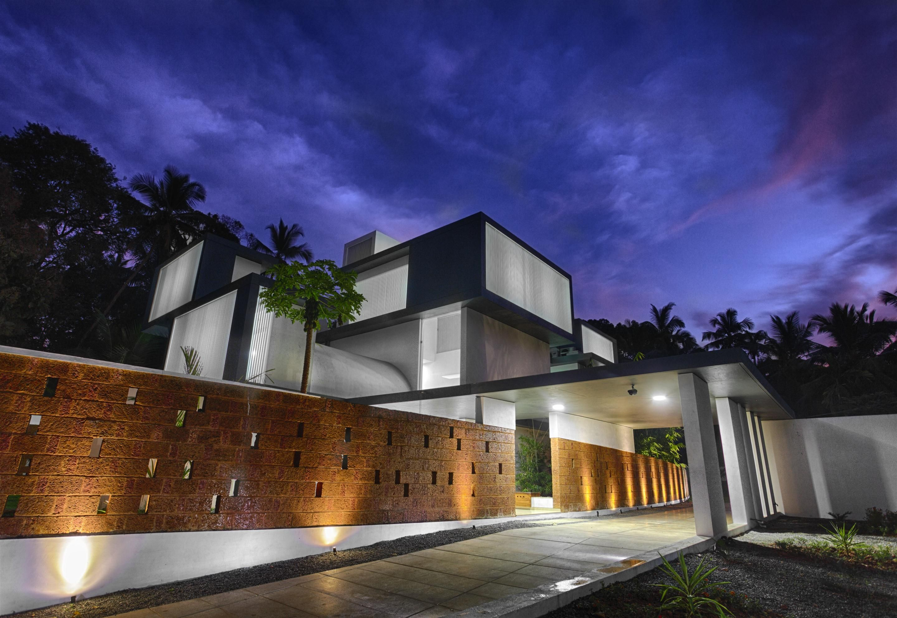 Shielded House Design Features Privacy Walls And Luxurious Interiors, In  Kerala