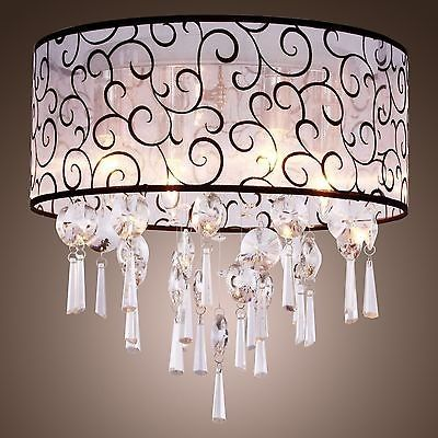 Hobby lobby carries the exact same sheer fabric to make this drum shade for your chandelier i wan to diy this asap to cover a dated chandelier in my dining