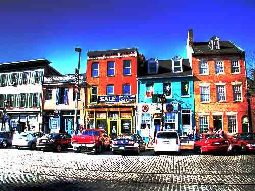 Thames St. in Fell's Point. Great food, shops, live music...don't wear heels & watch ya face on the Cobblestone!!