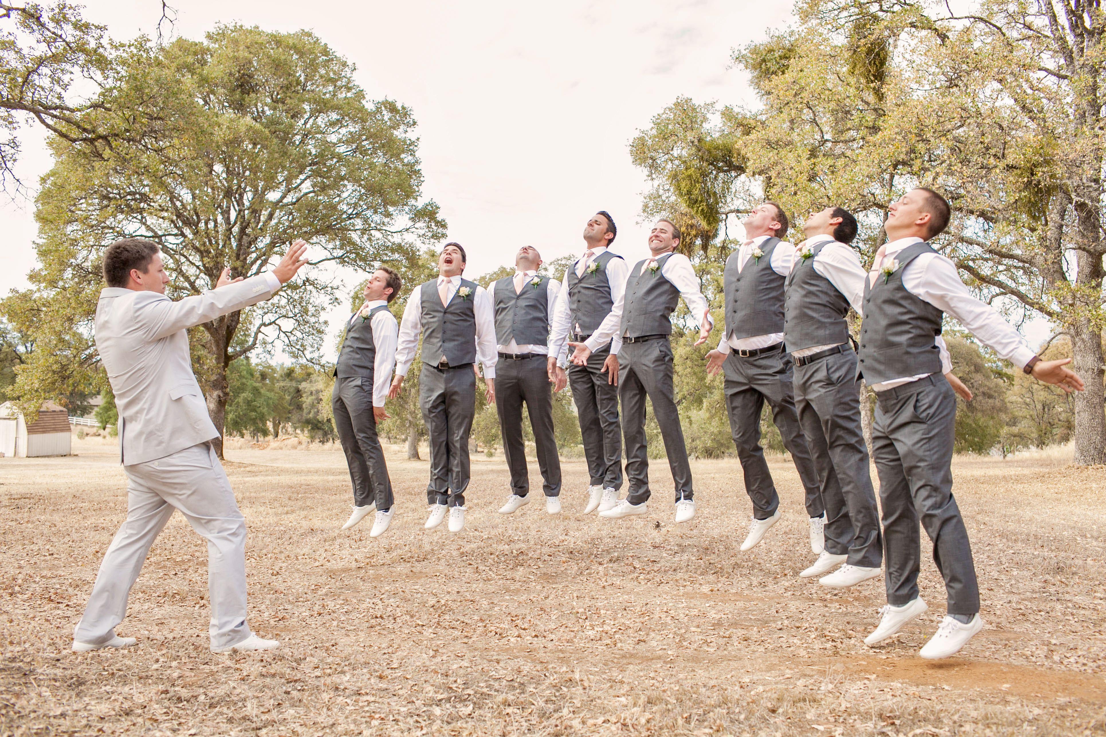 The groomsmen striking a funny pose