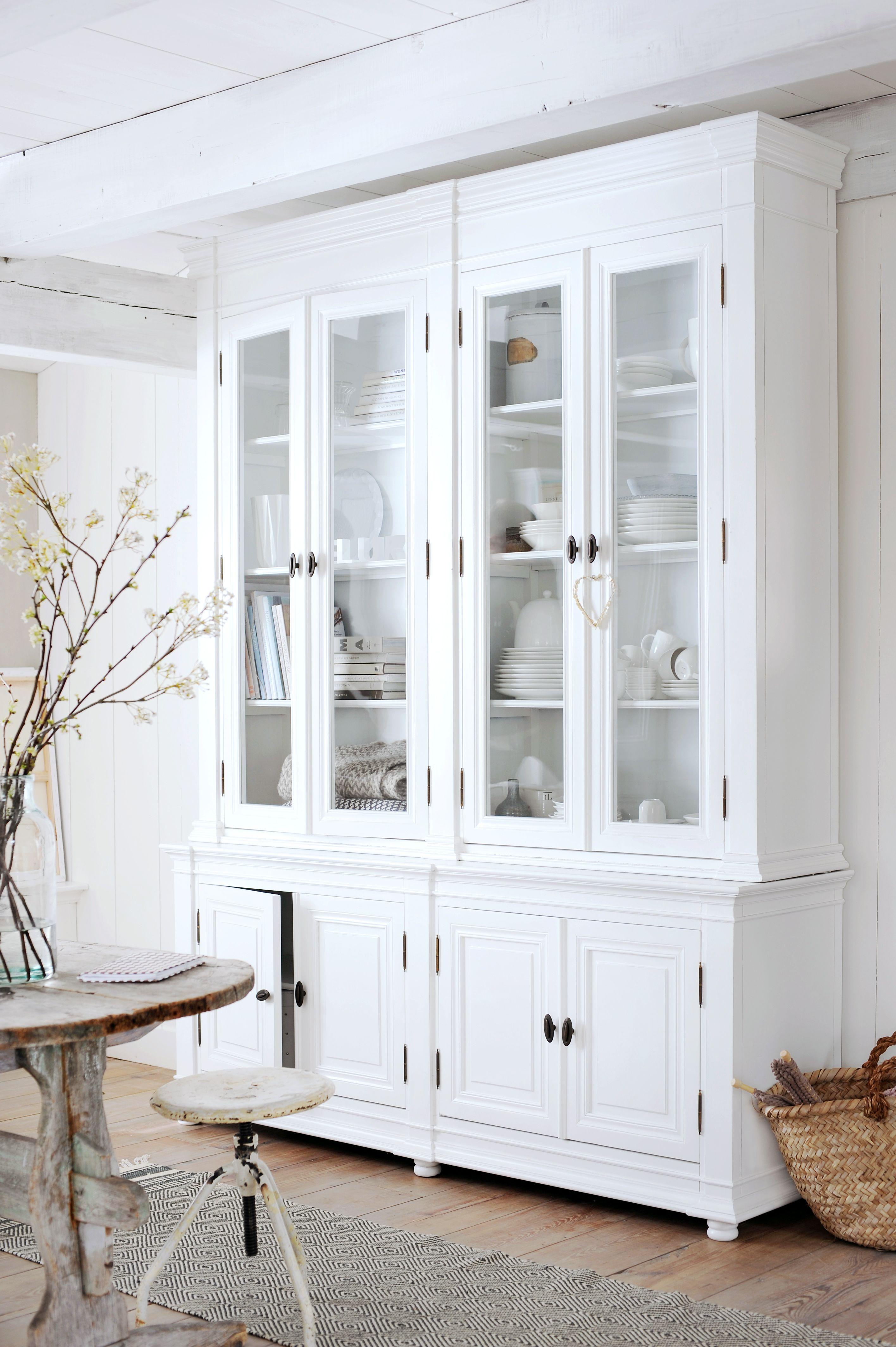 Fresh kitchen corner, love the tall storage piece and the round ...