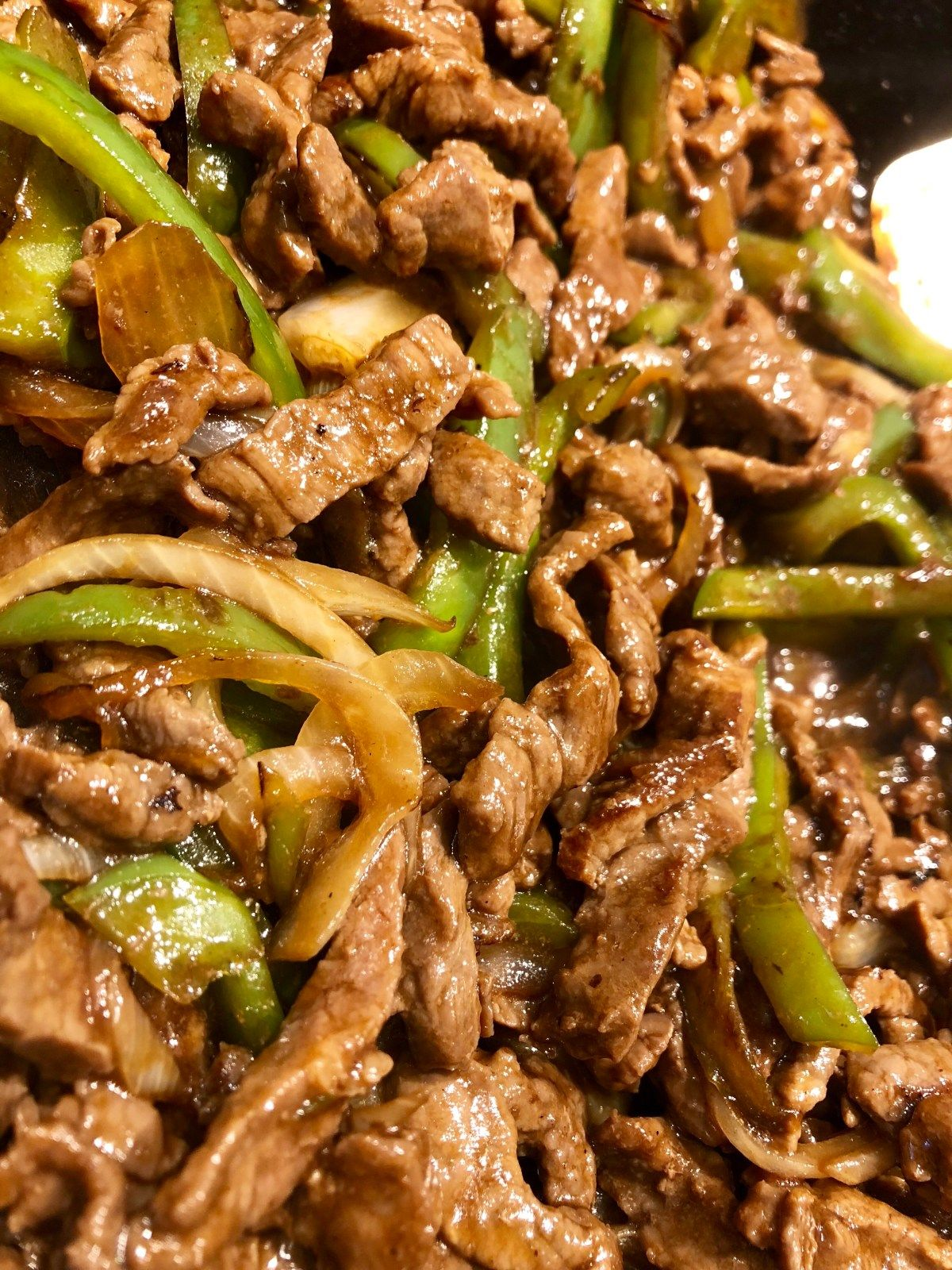 pepper steak is a tasty asian style dish served on a bed of white rice recipe pepper steak stuffed peppers easy steak recipes pinterest