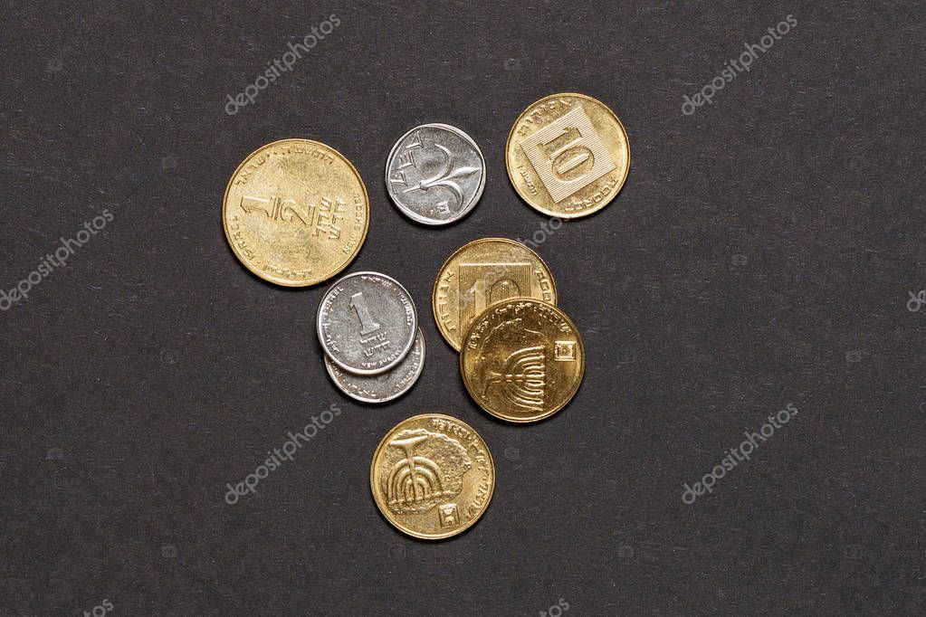 Different Israeli New Shekel Coins Stacked Black Background - Stock Photo ,