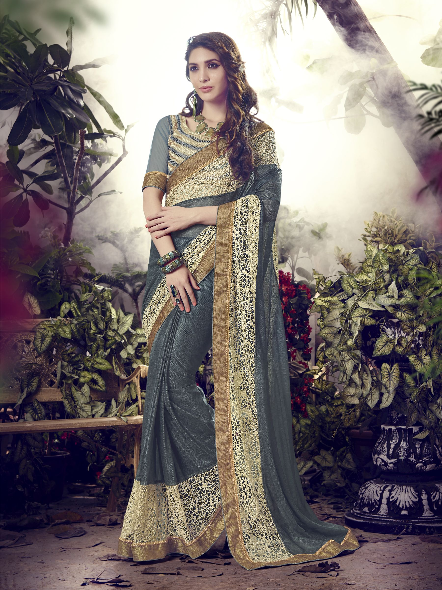 http://www.thatsend.com/shopping/lp/fvp/TESG230784/i/TE300642/iu/gray-lycra-traditional-saree  Gray Lycra Traditional Saree Apparel Pattern Embroidered. Work Embroidery, Border Lace. Blouse Piece Yes. Occasion Festive, Reception. Top Color Gray.