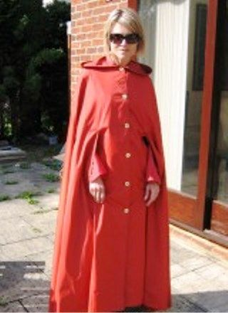 Long red rubberlined satin cape | Rubber-lined satin ...