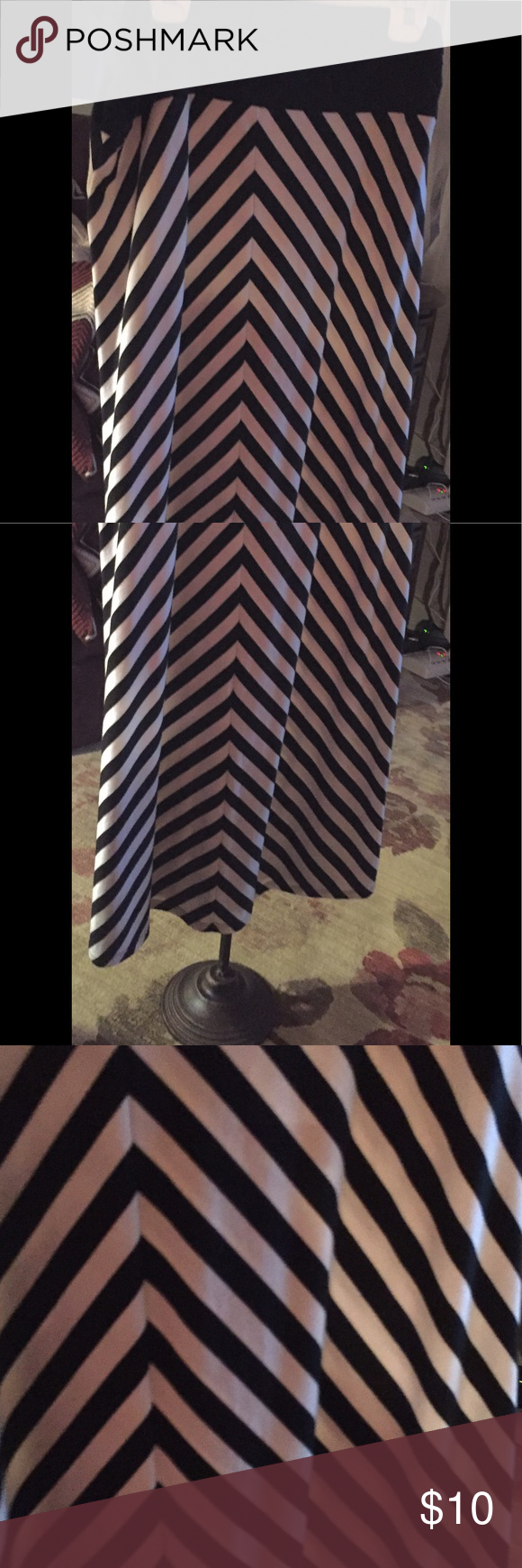 Chevron Maxi skirt Black/white maxi skirt with black elasticized waist band.  Excellent condition. No stains. Polyester/rayon/spandex.  XL (16-18) Faded Glory Skirts Maxi