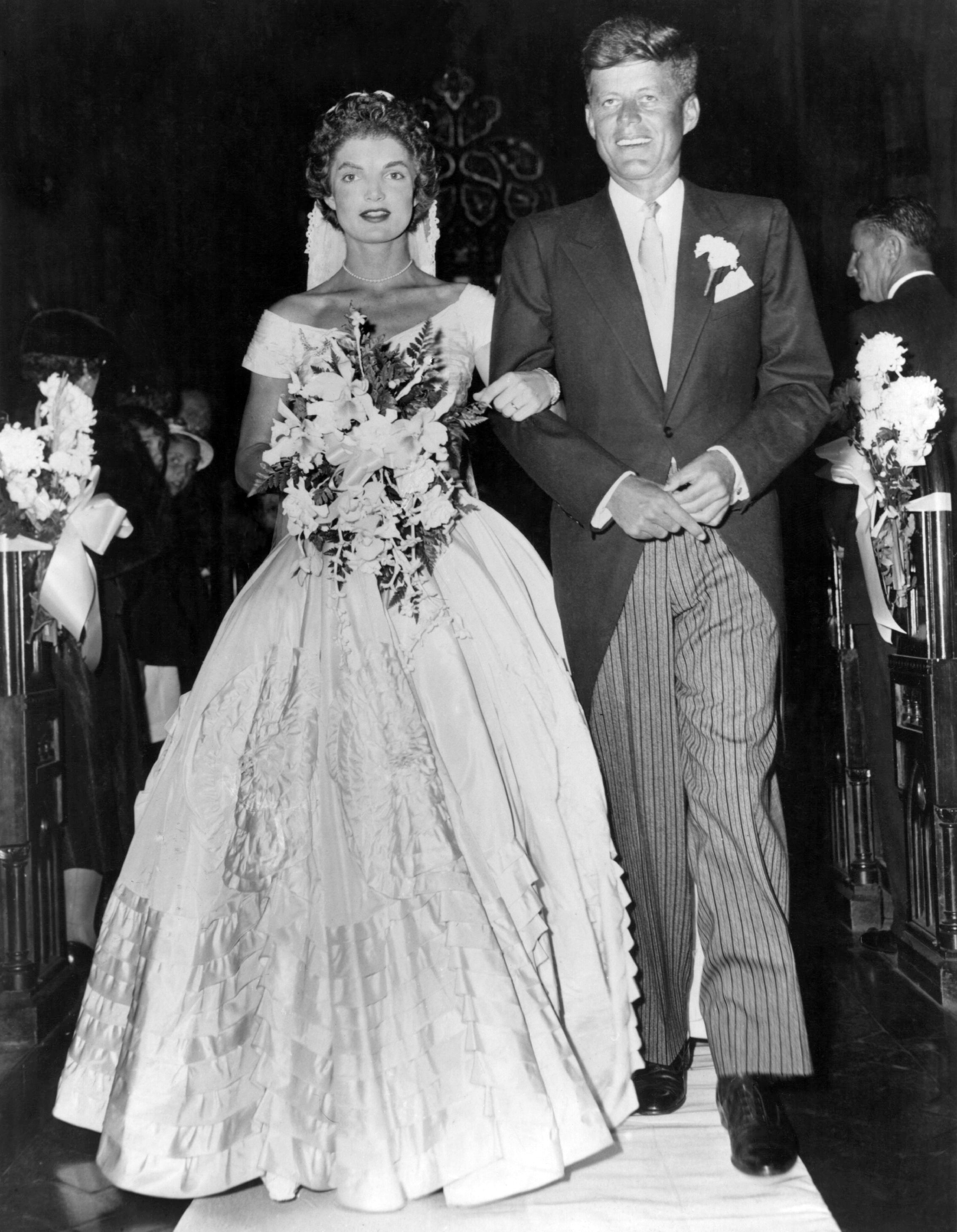 Fab edit 15 iconic celebrity wedding dresses john kennedy john senator john fitzgerald kennedy 1917 1963 democratic senator for massachusetts escorts his bride jacqueline lee bouvier 1929 1994 down the church junglespirit Gallery