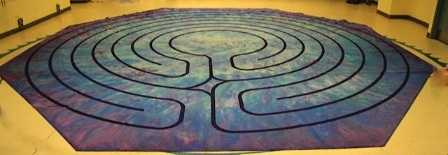 Painted Canvas labyrinth. The tonality from dark at the outside to light in the middle emphasises the meandering nature of the path.