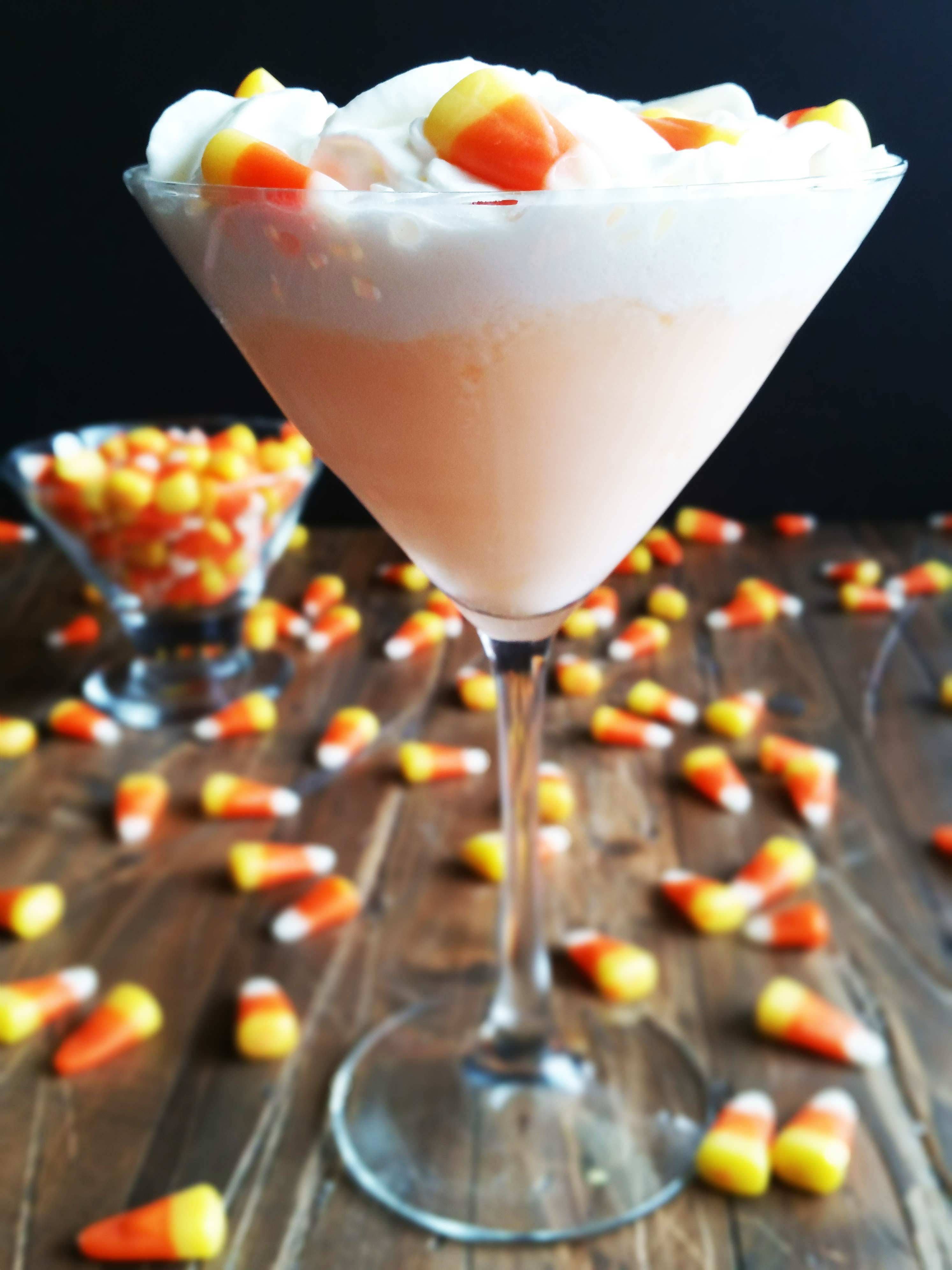 No need to eat all your trick-or-treaters' candy this year with this Candy Corn Martini! This is so creamy, dreamy and yumma, yumma, yumma! I made my first infused vodka with candy corn for this recipe and added a hint of butterscotch schnapps, half and half and pineapple juice.