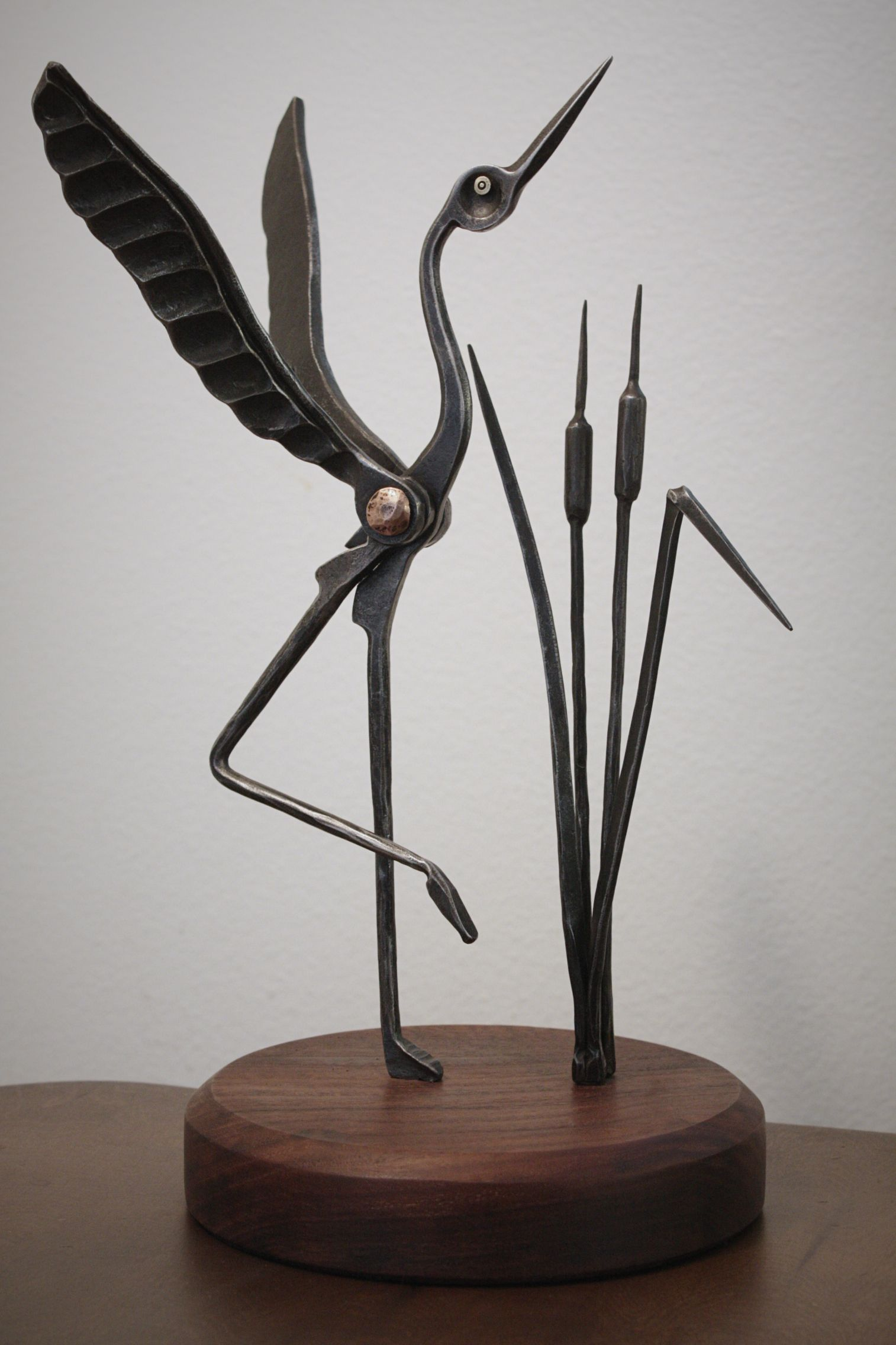 Added a base and cattails to the Brazeal style crane. By Jakob Faram