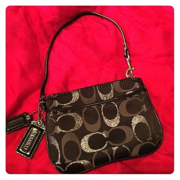 Coach® Small Classic Wristlet Coach Wristlet. Classic black and silver. Great condition. No damages. Used briefly. Coach Bags Clutches & Wristlets