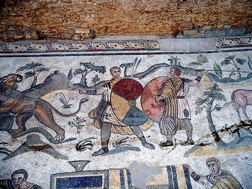 Soldiers from the Piazza Armerina mosaics. Note the footwear, military belts, tunicas with orbiculi and clavii.