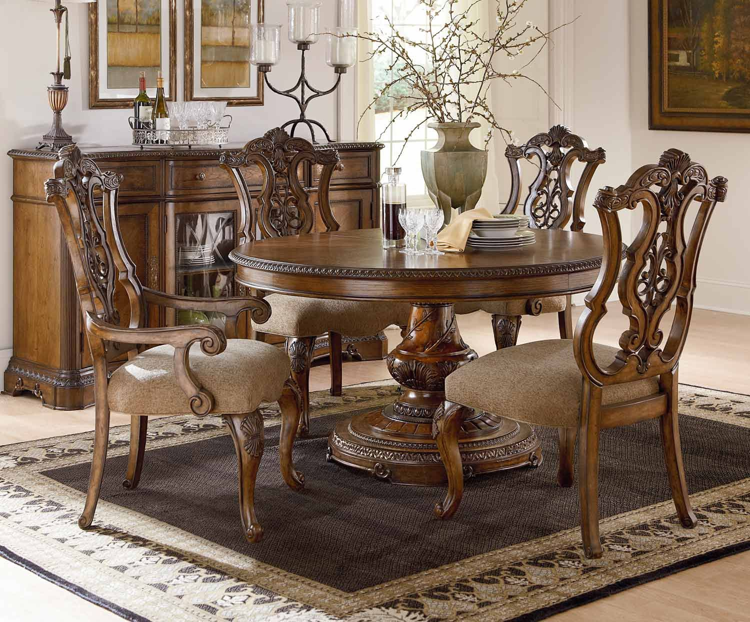 Legacy Classic Pemberleigh Round/Oval Dining Set with Pierced Chair - Brandy/Burnished Edges Legacy Classics Pemberleigh Round to Oval Table with Pierced Back Side Chairs and Arm chair  Features: Style: Gracious Living Wood: Poplar Solids, Cathedral Pecan Veneer & White Ash Burl Borders w/Primavera & Walnut Inlay Finish: Brandy w/Burnished Edges Hardware: Custom Designed Rings, Knobs & Escutcheons in Golden Amber Fabric Content: 100% Polyester (Doeskin), Cleaning Code: S