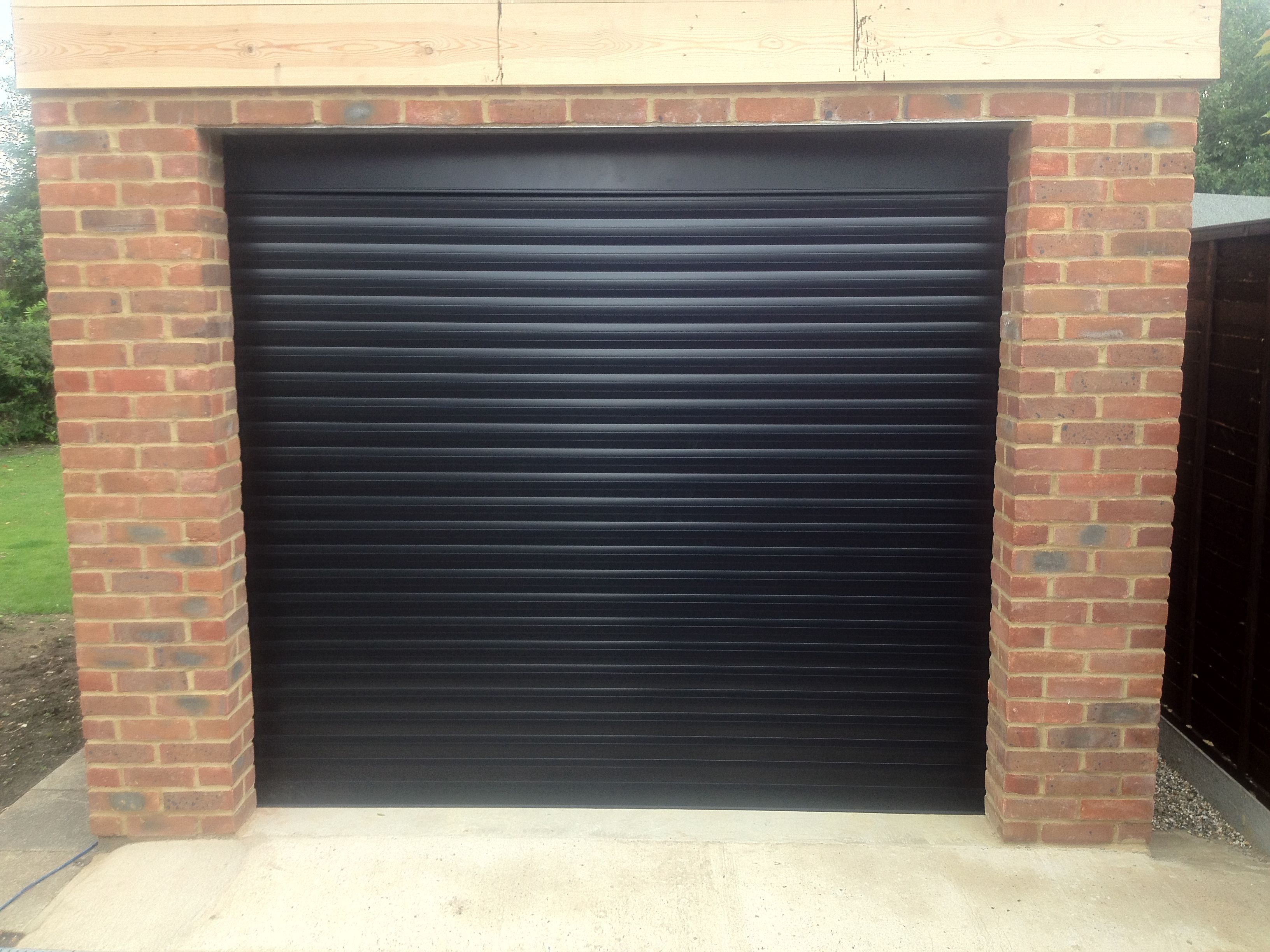 Rsg7000 Electrically Operated Security Roller Garage Doors Fitted Externally To A Residential Complex In Tootin Garage Doors Roller Doors Electric Garage Doors