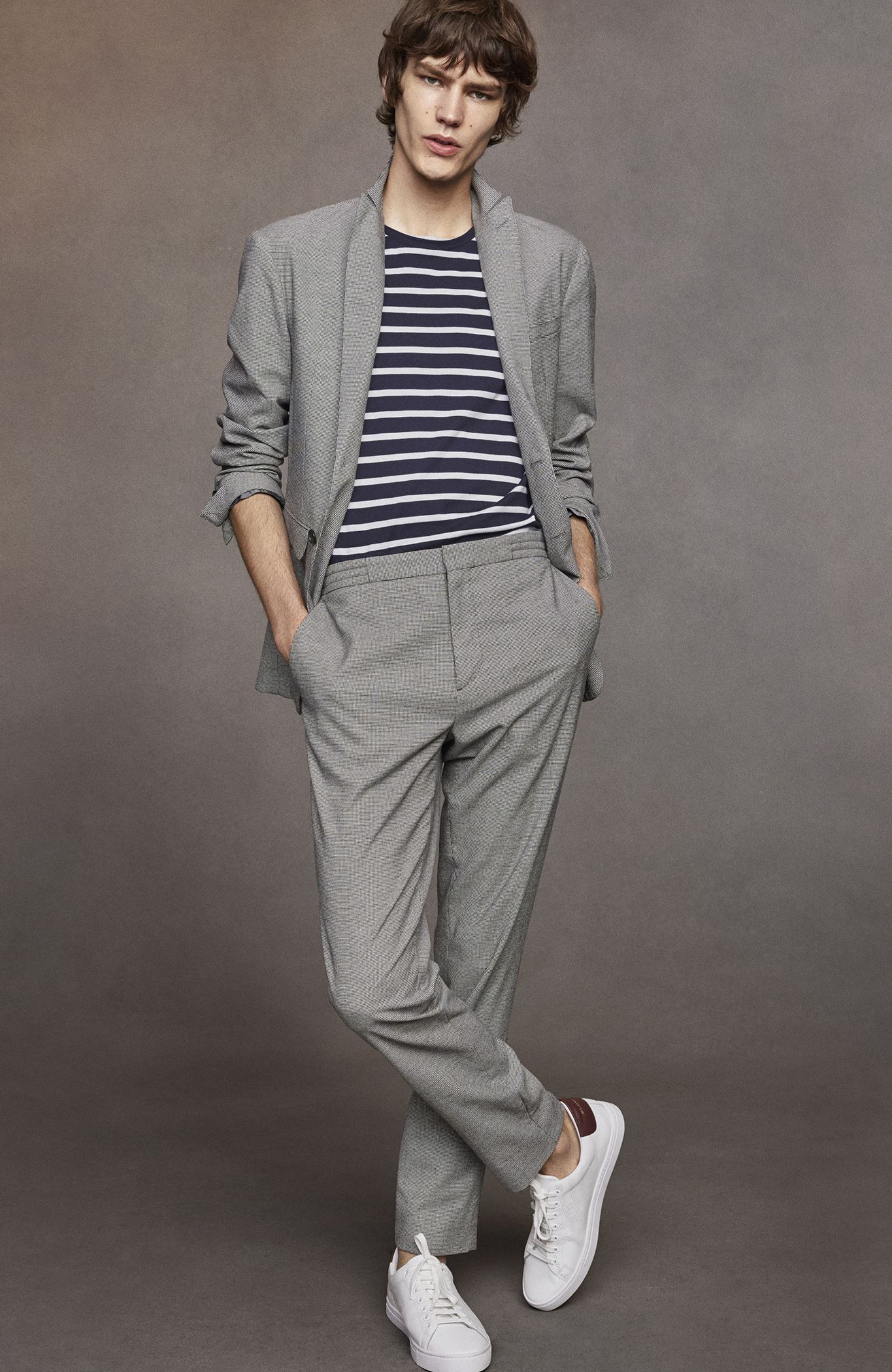 a5329a3943 A tailored modern-fit blazer and trousers in an Italian-woven cotton wool  blend with a micro houndstooth pattern. Blurring the lines between smart  and ...