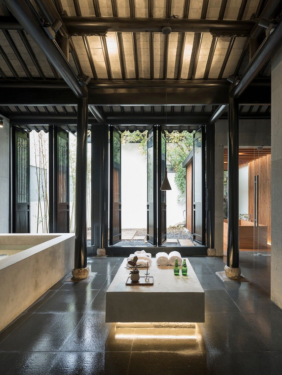 Communal zen spa set within a traditional chinese qing dynasty restoration