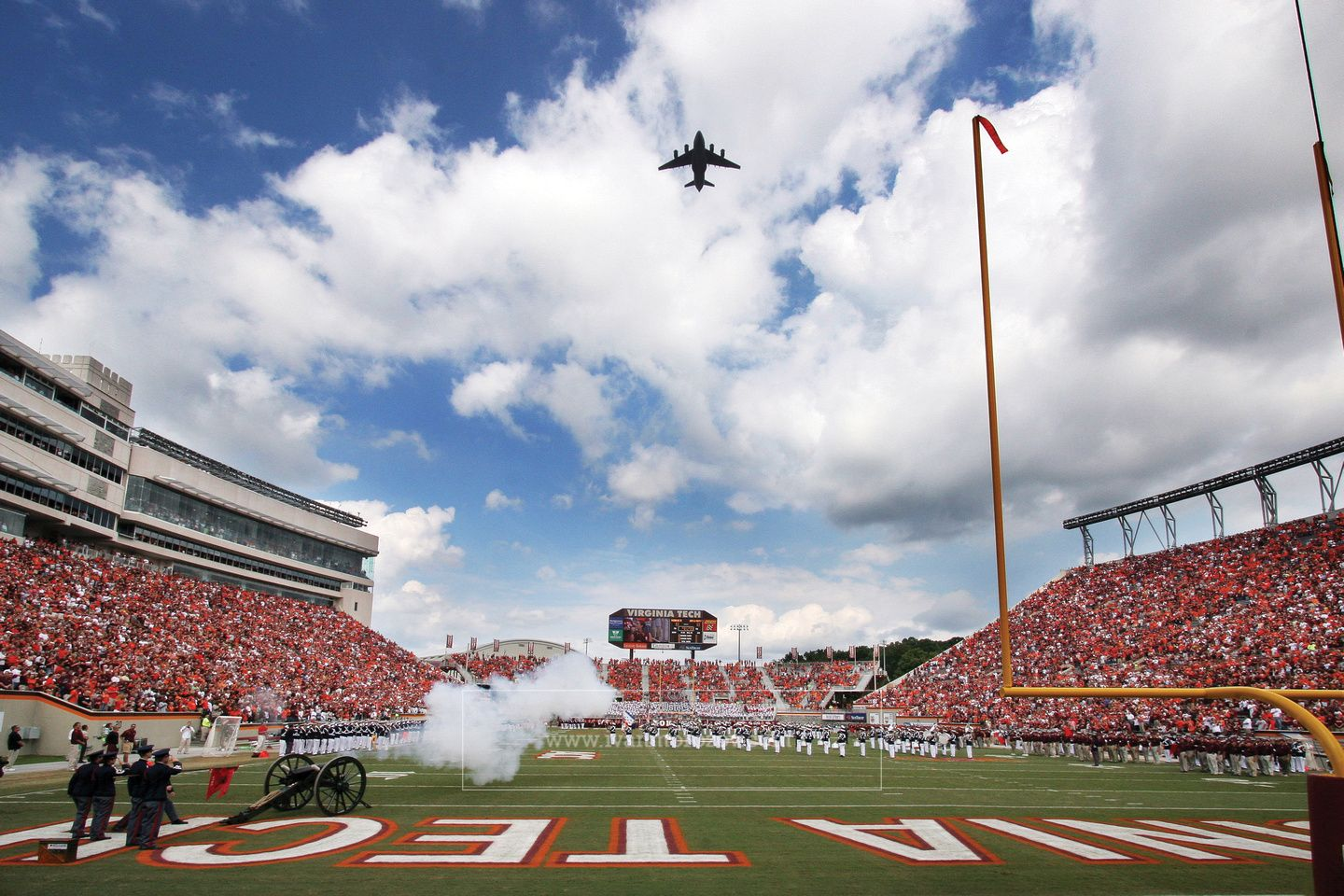 Pregame Flyover At Lane Stadium With Vtcc Canon The Skipper Firing During National Anthem Virginia Tech Lanestadium Virginia Tech Virginia Stadium