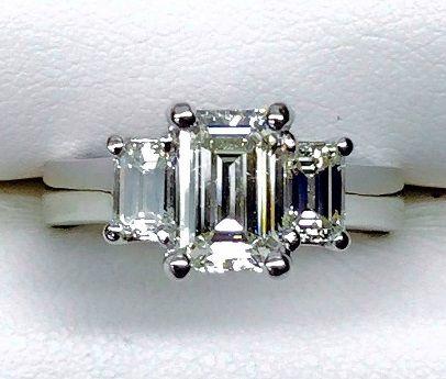 Emerald Cut Diamond Three Stone Engagement Ring in 14KW Gold.