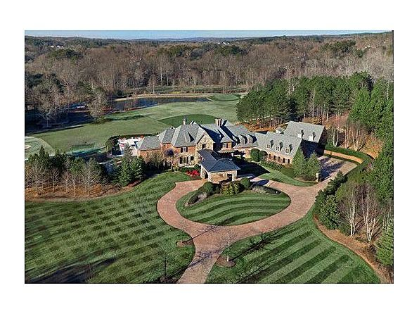 Retired Atlanta Brave John Smoltz's stunning, amenity-filled, double gated, estate on 22 acres including pool/spa; waterfalls & waterslide; separate tennis & basketball courts; 18 hole golf course; separate baseball & football fields; stocked fishing pond and jogging trail*Home exceeds expectations for both entertaining & quality with three finished levels of extensive custom craftsmanship; au par suite; studio apt; 8 car garage