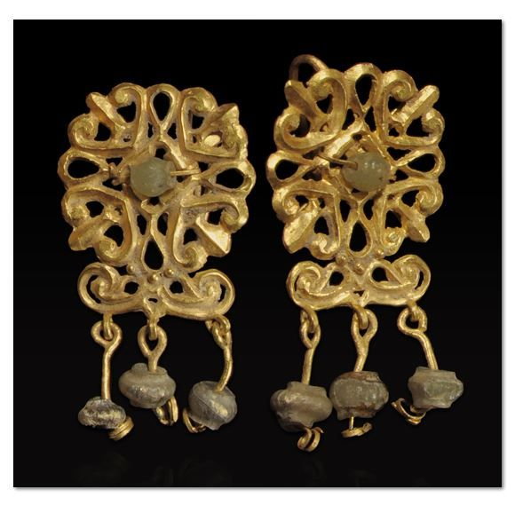 ROMAN GOLD OPENWORK EARRINGS WITH GREEN GLASS BEADS Designed as a stylized rosette centering a glass bead, atop a pair of volutes from which are suspended three glass beads - 3rd Century AD. | Royal-Athena