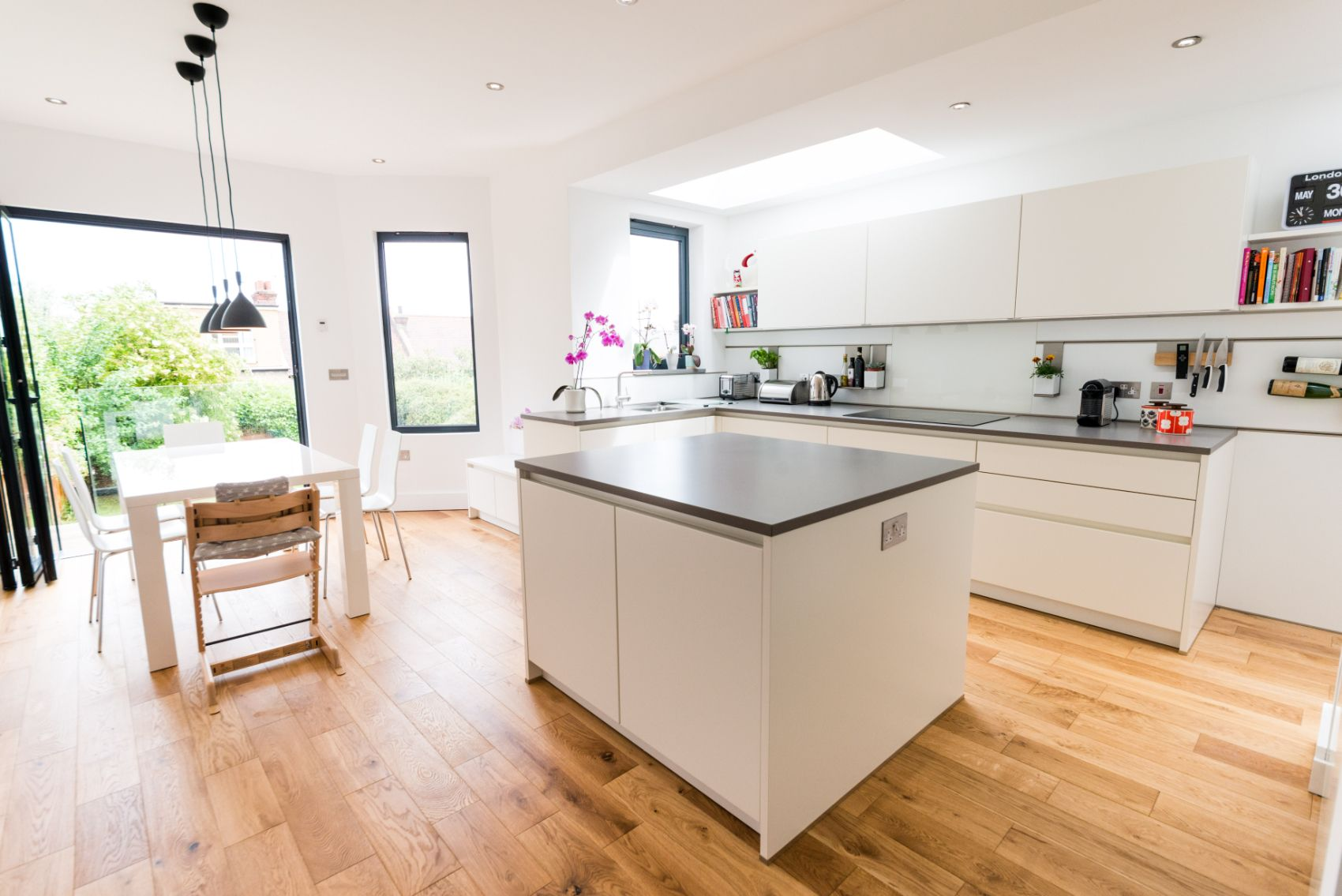 Bon A White Matt Handleless German Kitchen In Alexandra Park, London. The  Worktop Is Silestone And The Appliances Are Siemens.