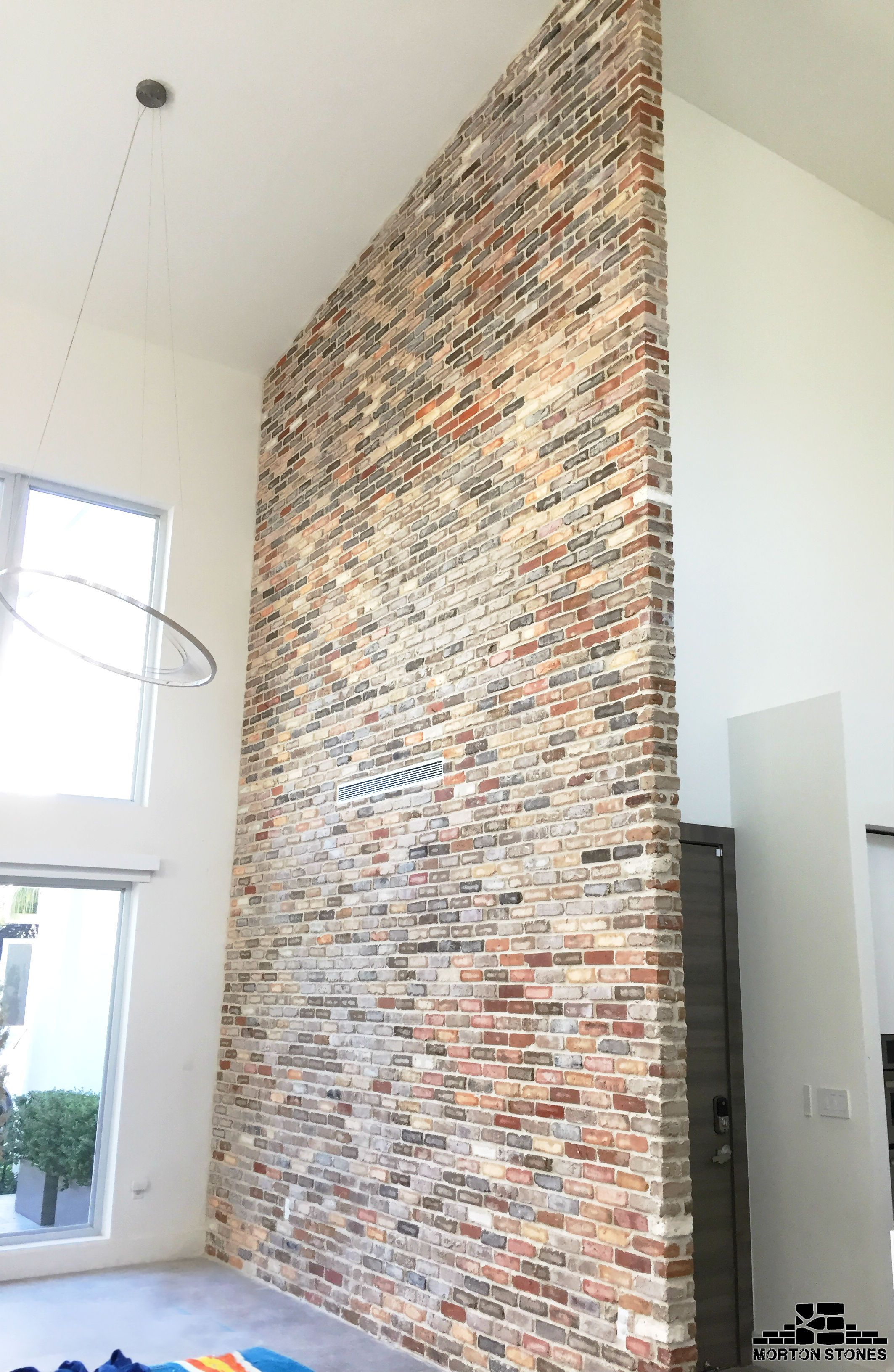 A Large And Trendy Brick Accent Wall In A Home With High Ceilings Mortonstones Brick Tiles Rustic H House Decor Rustic Rustic House Rustic Western Decor