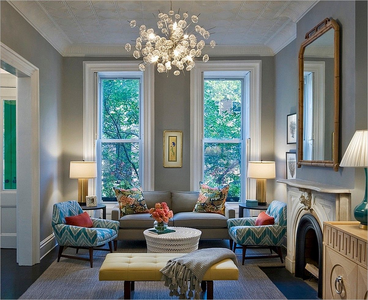 Awesome Soft Lighting Plays A Pivotal Role In Shaping The Feminine Living Space Decor With Elegant Seating Also Modular Chandelier And Brown Rugs: Trendy Feminine Living Room Design And Decor Ideas
